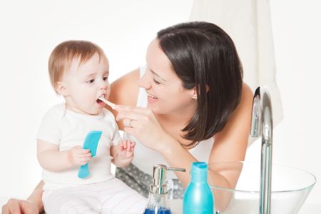cleaning baby's teeth twice a day with soft tooth brush